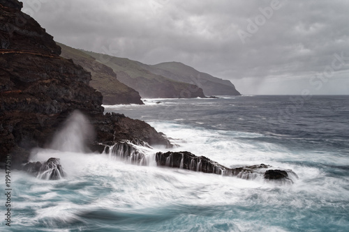 Plexiglas Canarische Eilanden Strong surf on a rocky coast in stormy weather, water movement in long exposure - Location: Spain, Canary Islands, La Palma