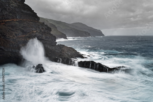 Deurstickers Canarische Eilanden Strong surf on a rocky coast in stormy weather, water movement in long exposure - Location: Spain, Canary Islands, La Palma