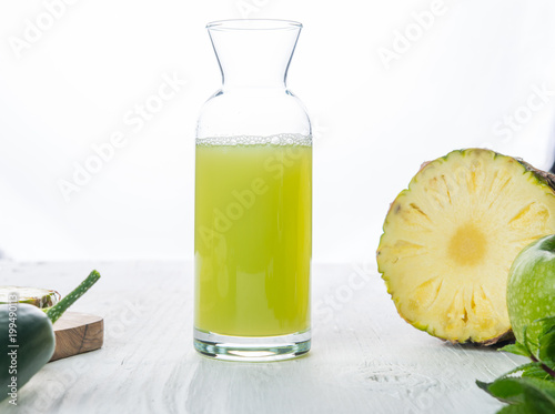 Pineapple, apple and cucumber juice in big glass