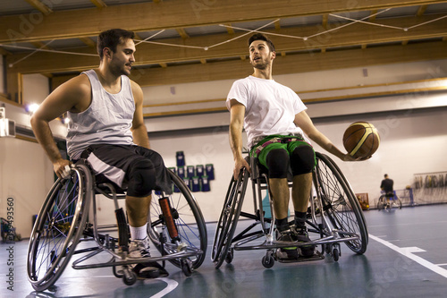 Foto Murales disabled sport men in action while playing basketball
