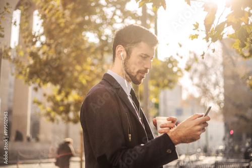 Foto Murales Businessman using a smartphone
