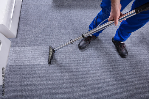 Janitor Cleaning Carpet - 199511179