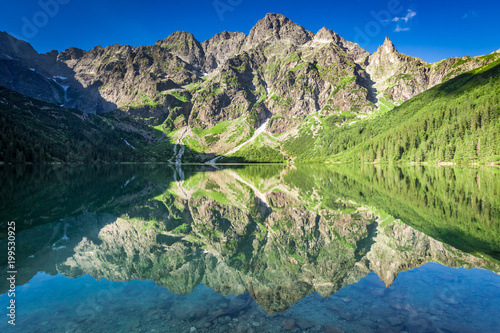 Fotobehang Groen blauw Stunning sunrise at lake in the Tatra Mountains, Poland