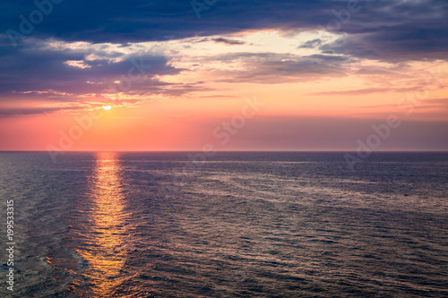 Foto op Plexiglas Ochtendgloren Dynamic dusk over calm ocean in summer, Baltic sea