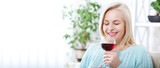 Closeup portrait of female customer drinking red wine with eyes closed. - 199543188