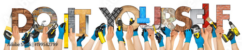 hand holding up tools and do it yourself diy letter lettering concept isolated on white background