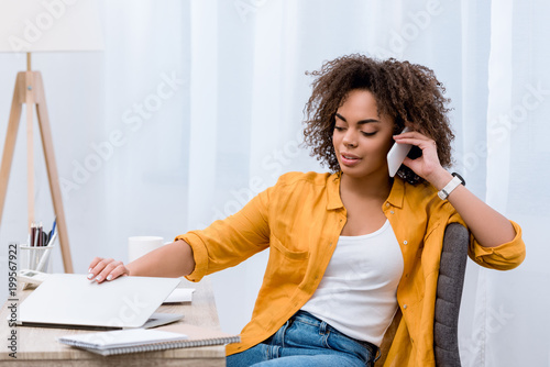 Fridge magnet african american young woman talking by phone at workplace
