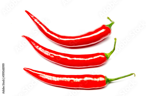 Fotobehang Hot chili peppers three chilies on a white background