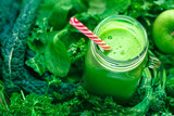 Fresh Leafy Greens Juice in a Glass Jar with a Red Striped Drinking Straw - 199569343