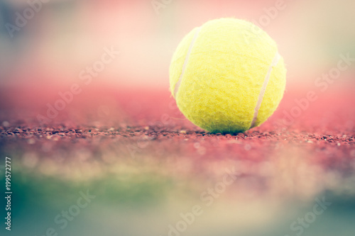 Plexiglas Tennis Sport Item concept : Tennis balls at red court in summer day. Tennis is racket sport that can be played individually against single opponent (singles) or between two teams of two players each.
