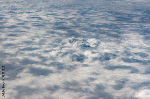 clouds in the sky from airplane window - 199578325