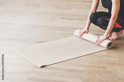 Obraz na płótnie Woman makes the yoga exercise on the mat, indoors