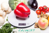 Weigh products on electronic kitchen scales and record the results. The concept of healthy eating, diet, calorie counting, eating restrictions - 199584709