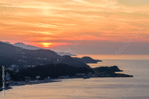 Foto op Canvas Zee zonsondergang Beautiful sunset on the sea. The coastline of the island of Samos in the time of sunset, Samos island, Greece