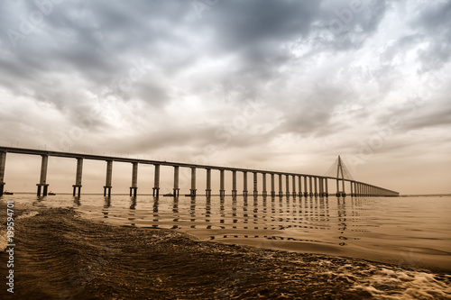 Bridge over sea in manaus, brazil. Road passage over water on cloudy sky. architecture and design. Travel destination and wanderlust