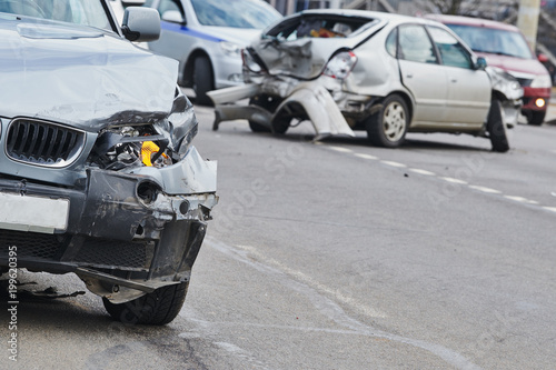 Fridge magnet car crash accident on street, damaged automobiles after collision in city