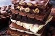 Leinwanddruck Bild - Chocolate bars on dark background with chocolate tower