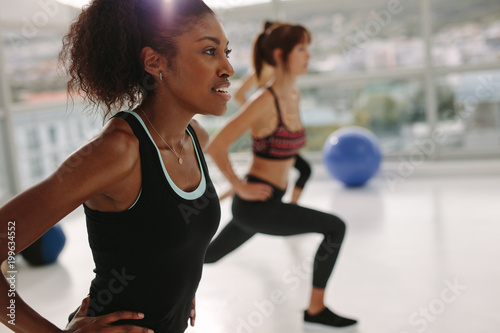 Foto op Aluminium School de yoga Woman exercising in gym class