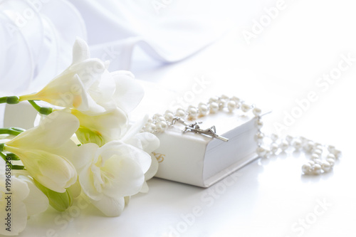 First holy communion symbol background concept with rosary and flowers