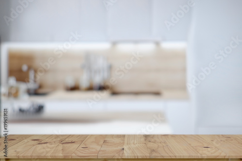 Empty wooden table top and kitchen background. for food and product display montage