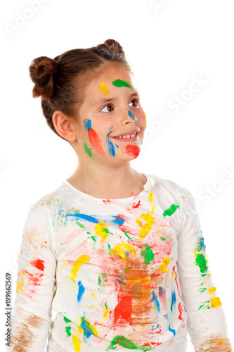 Pensive girl with hands and face full of paint isolated on a white background