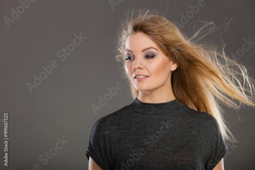 Foto op Plexiglas Kapsalon Attractive blonde woman with windblown hair