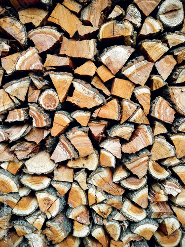 In de dag Brandhout textuur Copy space. Ends of logs wooden background. Wood in the stack.