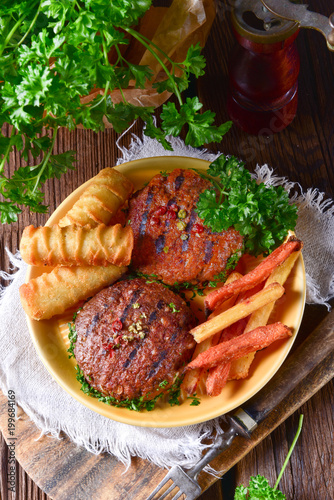 grilled bullets with croquettes and vegetables