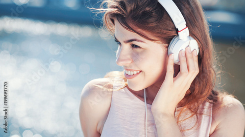 Fotobehang Muziek Beautiful girl with headphones