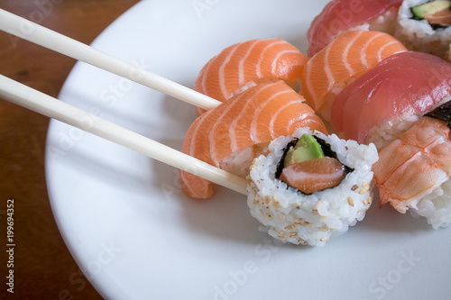 Foto op Plexiglas Sushi bar Fresh sushi in a white bowl with chopsticks