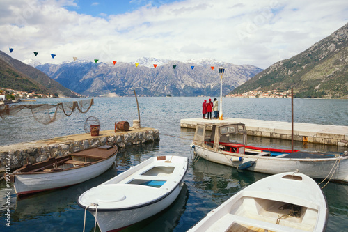 Foto op Canvas Wit Cold day. Montenegro, view of Bay of Kotor near small harbor with fishing boats in Stoliv village