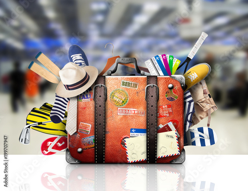 Foto Murales Retro suitcase of a traveler with travel stickers