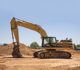 Construction site with backhoe excavator