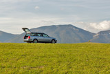 hatchback car on the top of the hill