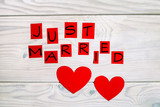 Text just married  and heart shapes on wooden table. - 199719736
