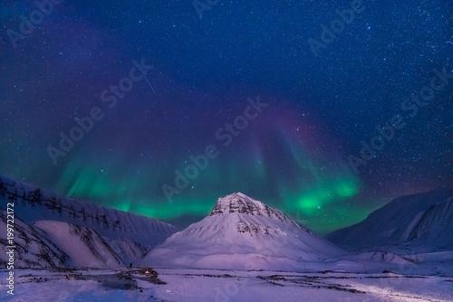 Poster Aubergine The polar arctic Northern lights aurora borealis sky star in Norway Svalbard in Longyearbyen city man mountains