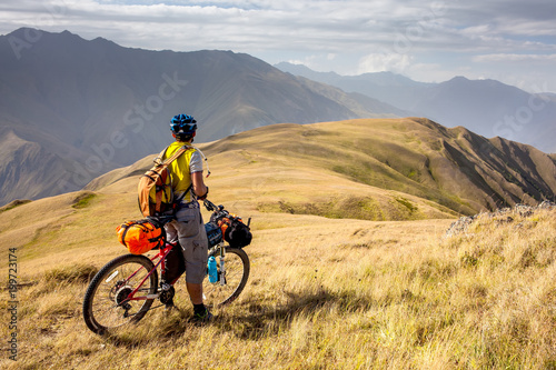 Mountain biker is travelling in the highlands of Tusheti region, Georgia - 199723174
