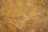 Weathered yellow painted wall background, partially faded - 199726320
