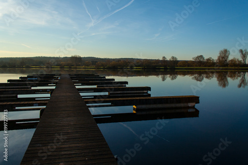 Plexiglas Pier lake kinzig at the golden hour