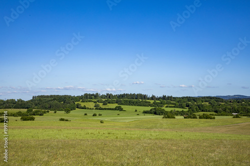 typical rural landscape with meadows and fields in the Jura region, departement Bourgogne - 199729714