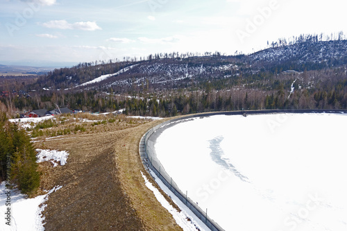 Frozen water reservoir in the mountains