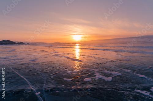Fotobehang Lavendel Beautiful sunset over freezing Baikal water lake in winter season Russia
