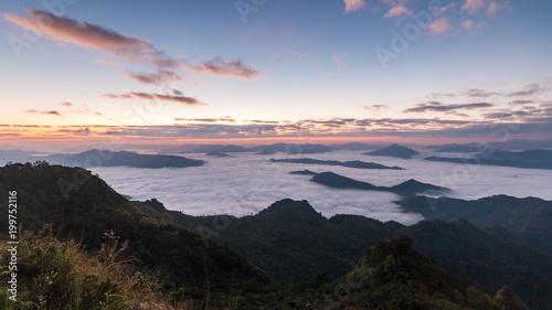 In de dag Ochtendgloren Beautiful Sunrise of travel place with morning mist at Phu chi dao/Phu chee dao in Chiangrai,Thailand