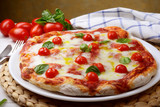 Pizza margherita with cherry tomatoes
