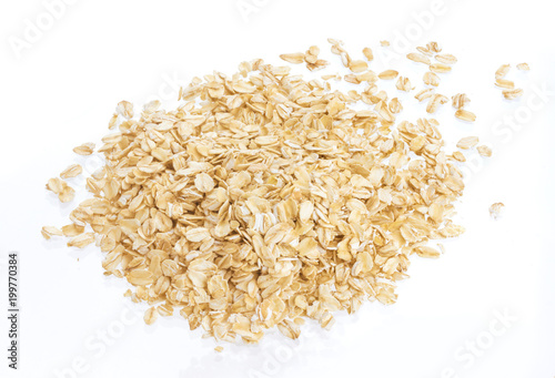 Oat flakes isolated on white background. Top view. Close up.