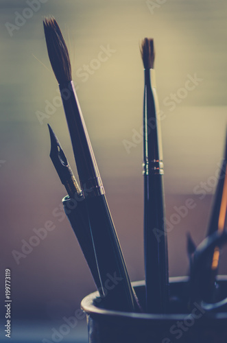 Foto Murales paint brushes and nibs in a cup