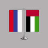 Table stand with flags of Russia and United Arab Emirates.Two flag. Flag pole. Symbolizing the cooperation between the two countries.Table flags