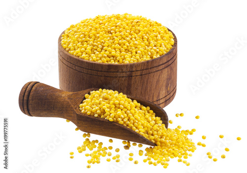 Millet in wooden bowl isolated on white background. Close-up