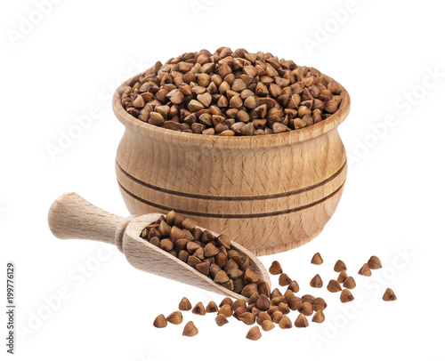 Buckwheat in wooden bowl isolated on white background