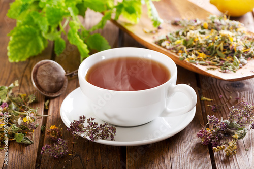 Cup of herbal tea with various herbs - 199785539